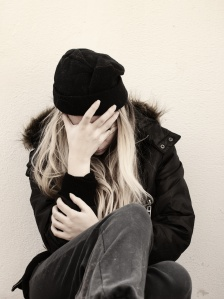 Depressed young homeless woman